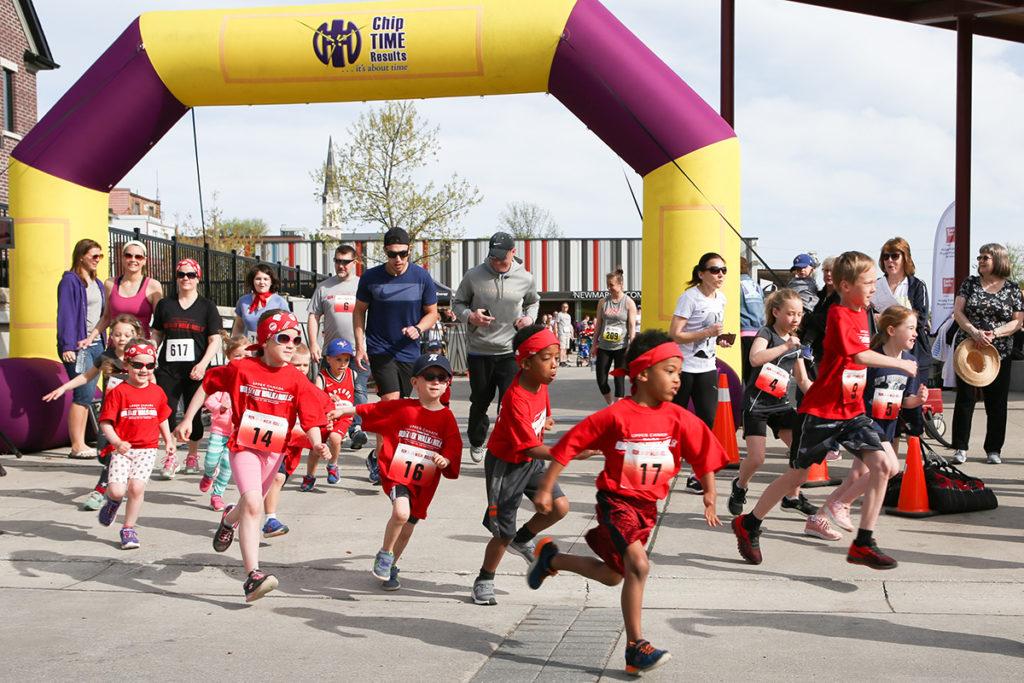 Kids run in red shorts for theKids Kilometer
