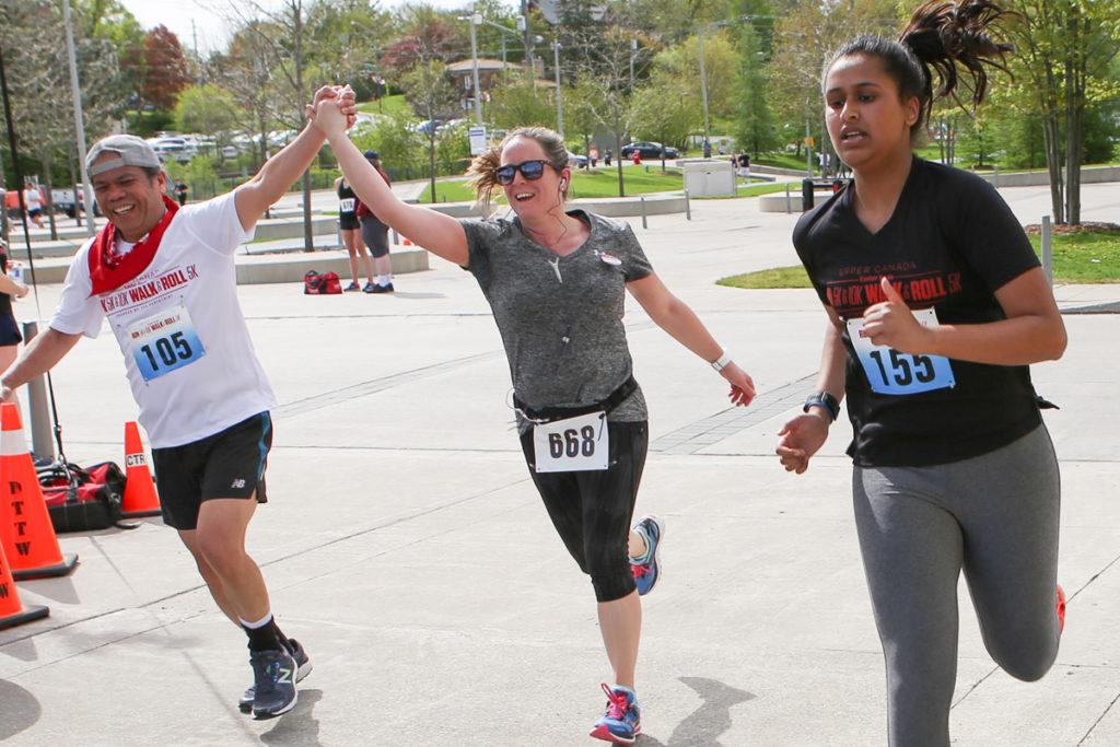 Runners pass the finish line